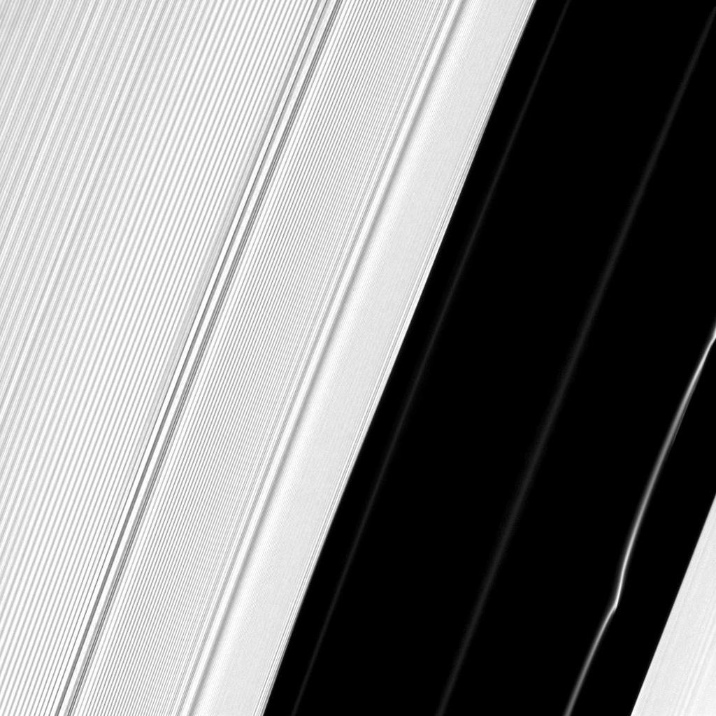 Several structures in Saturn's A ring are exposed near the Encke Gap in this image captured by NASA's Cassini spacecraft. A peculiar kink can be seen in one particularly bright ringlet at the bottom right.