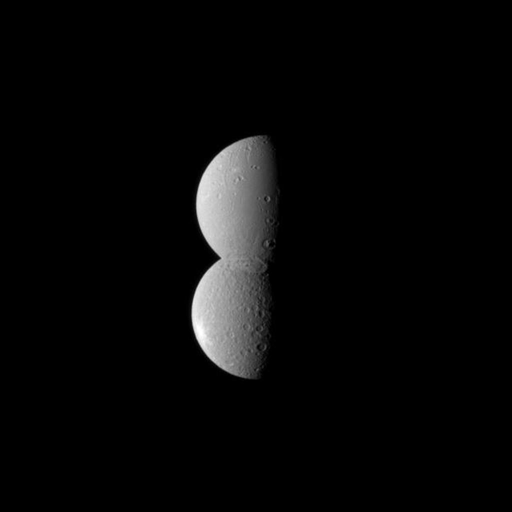 Looking like half of a figure eight, two of Saturn's moons appear conjoined in this image from NASA's Cassini spacecraft. The moon Dione, at the top in the image, is actually closer to the spacecraft, appearing to blend seamlessly with the moon Rhea.