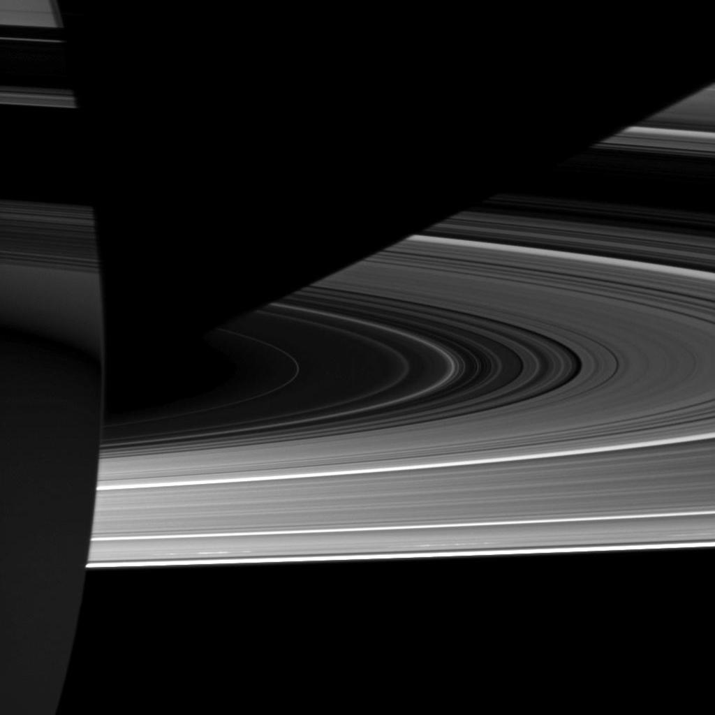Capturing the interplay between light and shadow, NASA's Cassini spacecraft looks toward the night side of Saturn where sunlight reflected off the rings has dimly illuminated what would otherwise be the dark side of the planet.