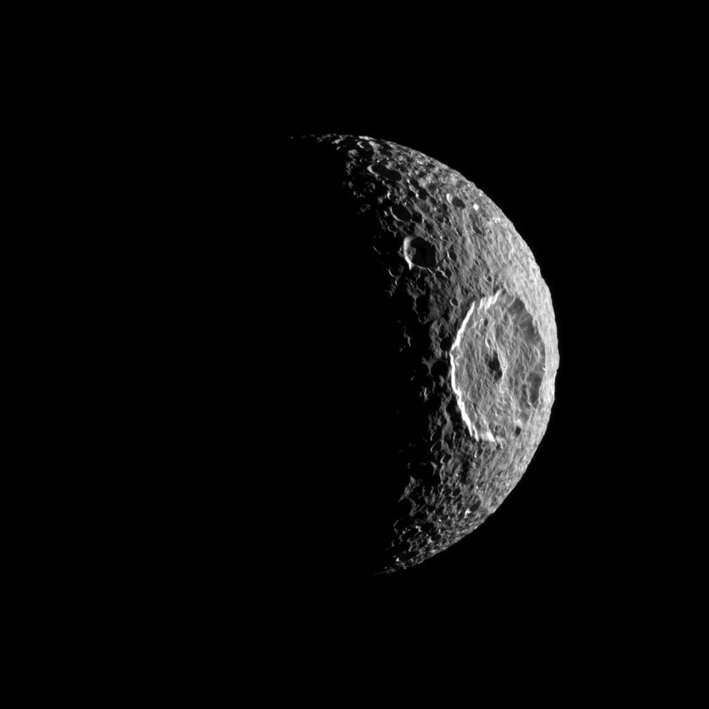 NASA's Cassini spacecraft turns the eye of its camera toward Saturn's moon Mimas and spies the large Herschel Crater which itself looks like the iris of an eye peering out into space.