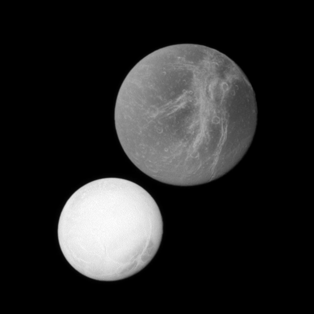 At top of this image, Saturn's moon Dione may appear closer to the spacecraft because it is larger than the moon Enceladus in the lower left. However, Enceladus was actually closer to the spacecraft in this image captured by NASA's Cassini spacecraft.