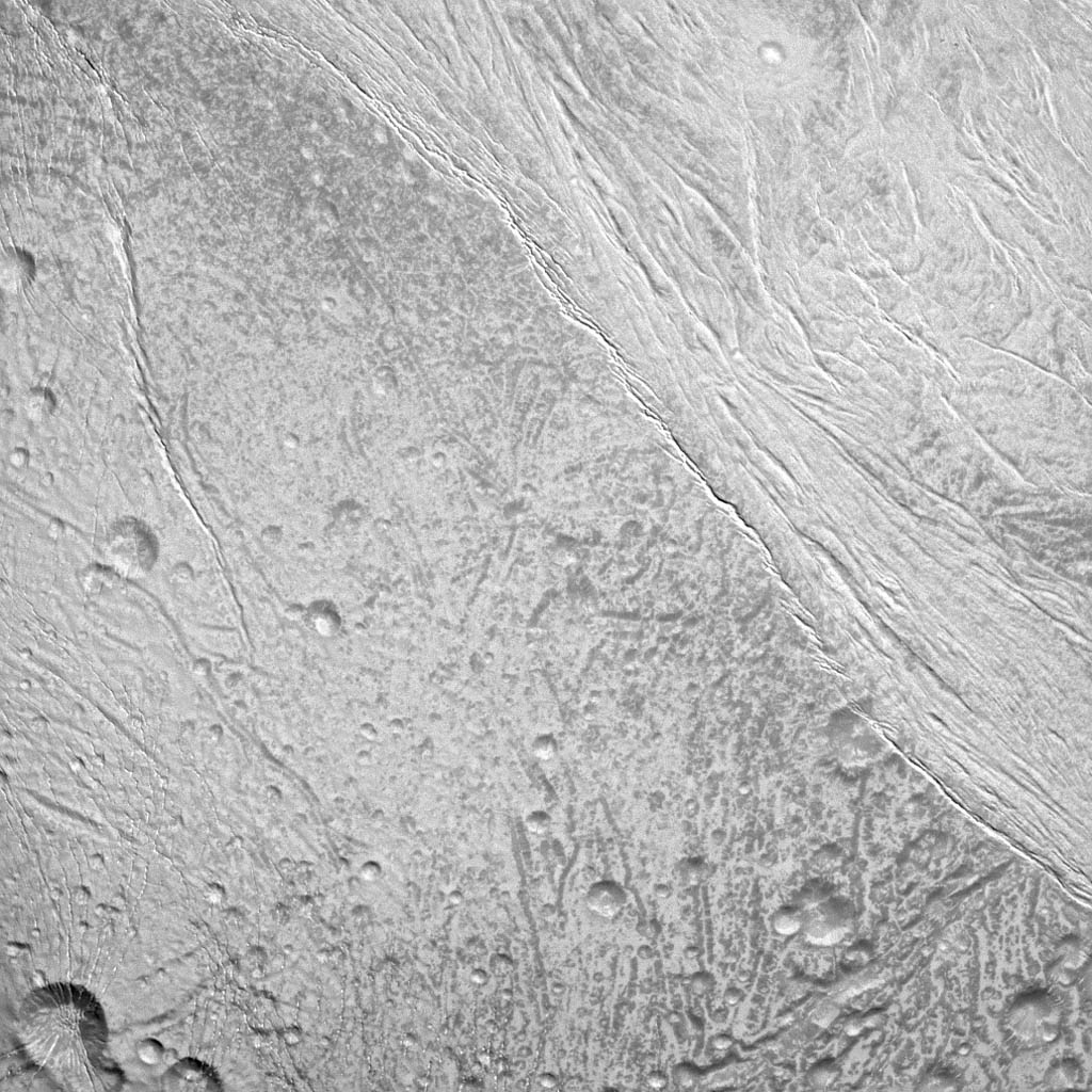 NASA's Cassini spacecraft surveys the surface of Saturn's moon Enceladus in this image, which shows newly created terrain in the upper right meeting older, cratered terrain in the lower left.