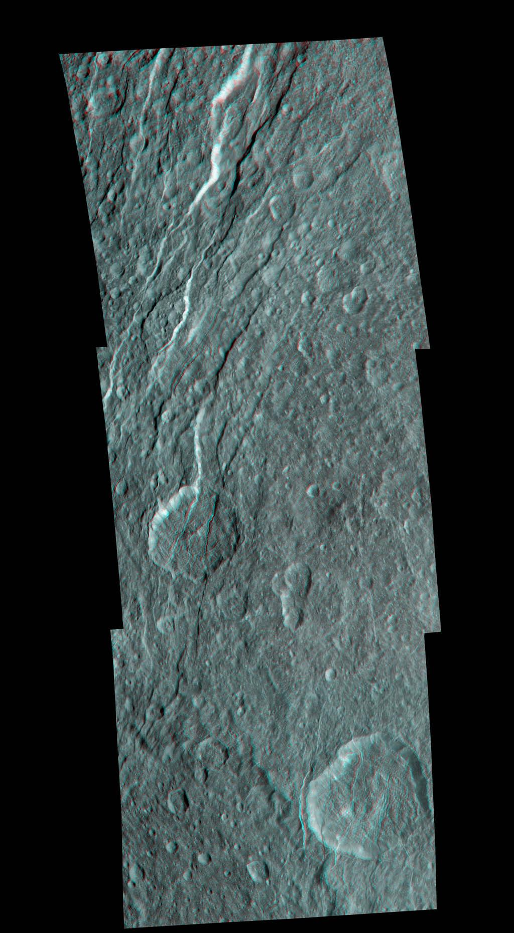 Wispy fractures cut through cratered terrain on Saturn's moon Rhea in this high resolution, 3-D image from NASA's Cassini spacecraft. The image shows a level of detail not seen previously.