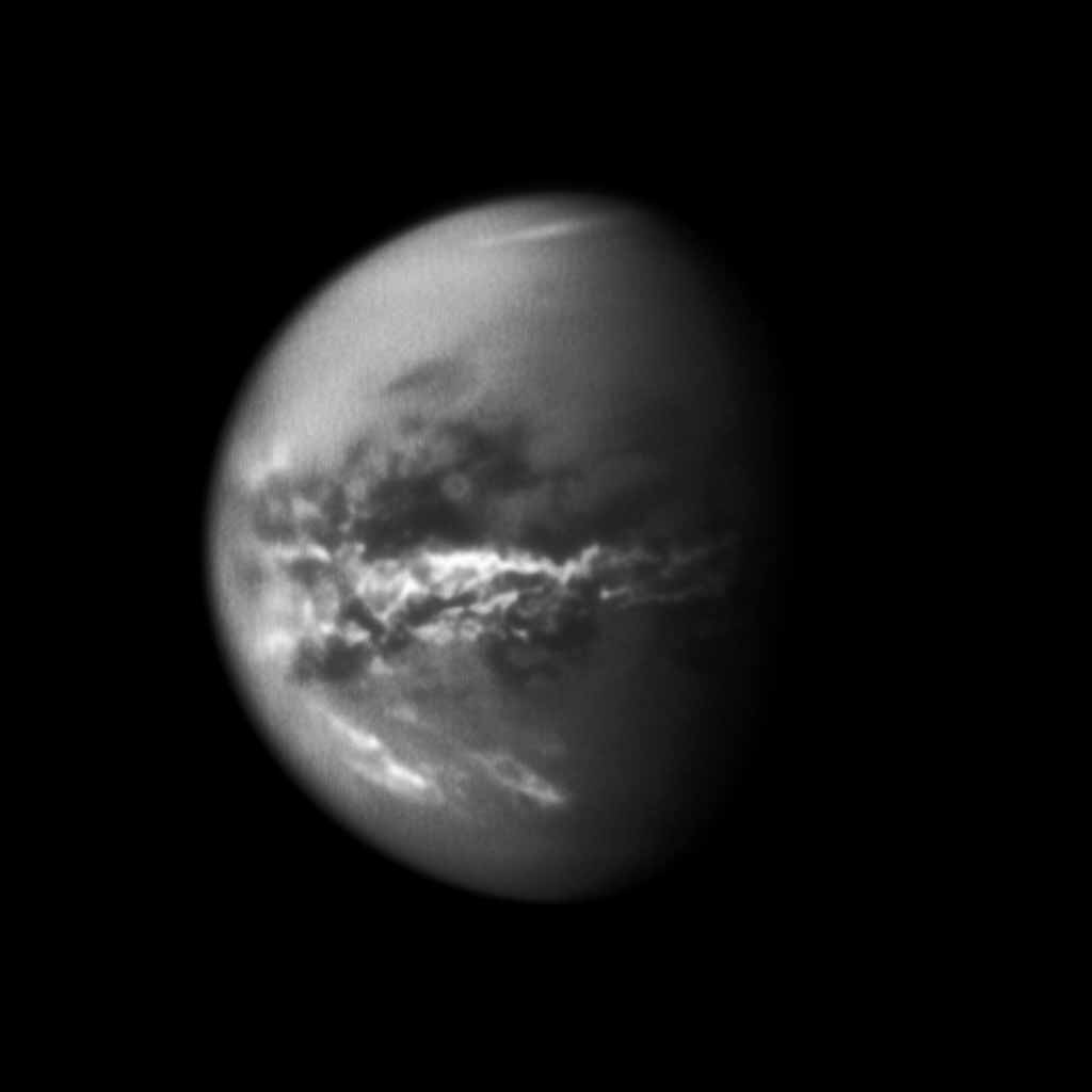 NASA's Cassini spacecraft chronicles the change of seasons as it captures clouds concentrated near the equator of Saturn's largest moon, Titan. Methane clouds in the troposphere, the lowest part of the atmosphere, appear white here.