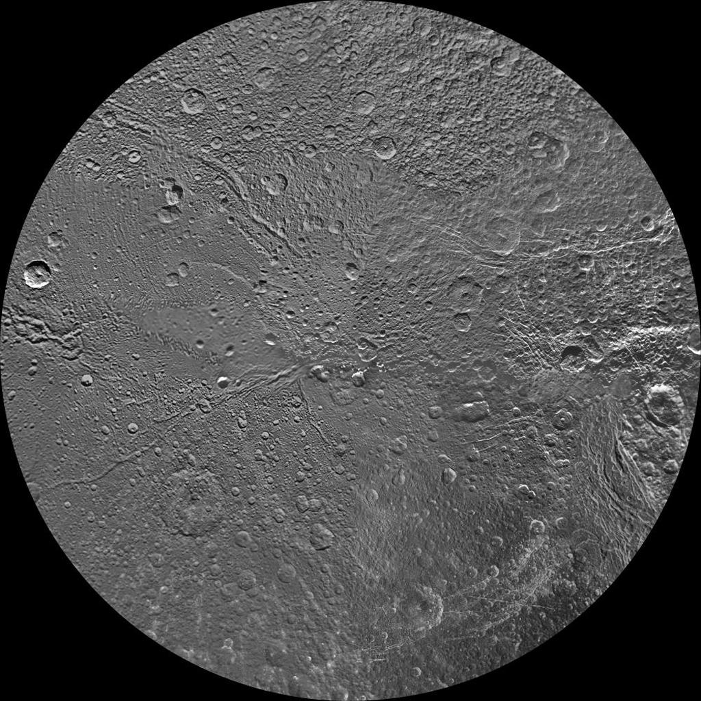 The northern and southern hemispheres of Dione are seen in these polar stereographic maps of the north pole, mosaicked from the best-available clear-filter images from NASA's Cassini and Voyager missions.
