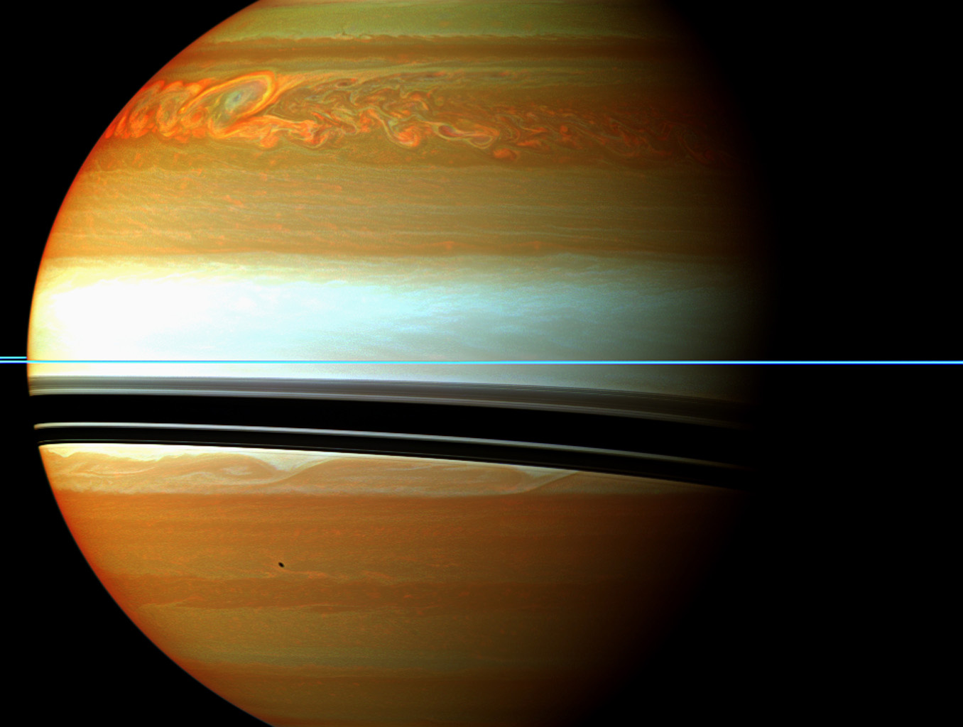 This false-color mosaic from NASA's Cassini spacecraft shows the tail of Saturn's huge northern storm. The head of the storm is beyond the horizon in this view.