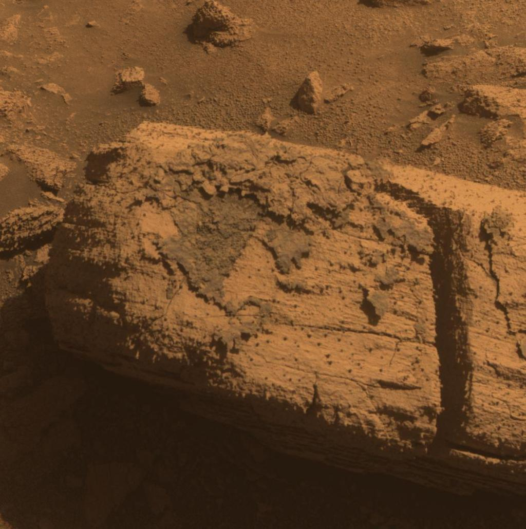 This image from the panoramic camera on NASA's Mars Exploration Rover Opportunity shows a rock called 'Chocolate Hills,' which the rover found and examined at the edge of a young crater called 'Concepción.'