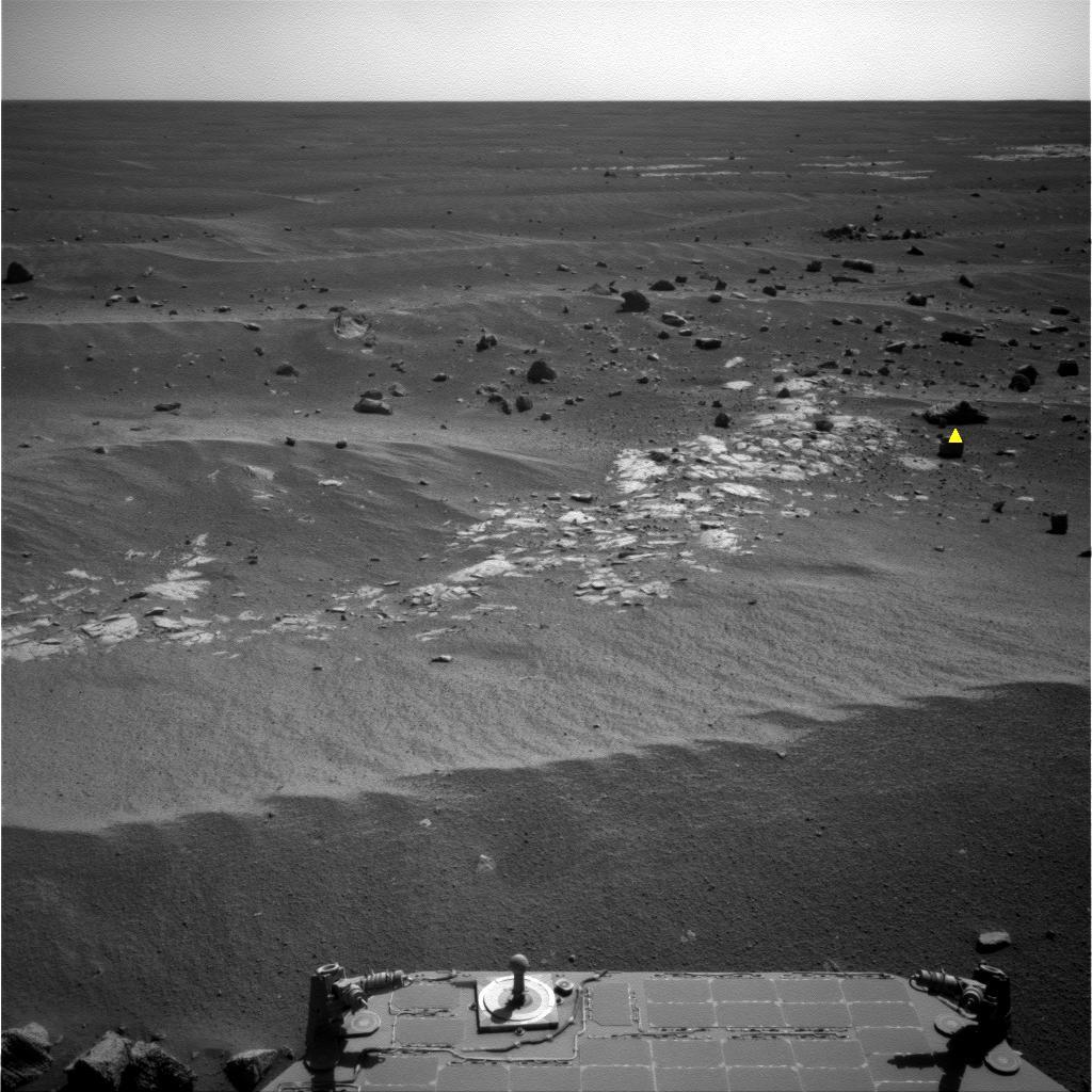 NASA's Opportunity used newly developed and uploaded software called AEGIS, to analyze images to identify features that best matched criteria for selecting an observation target; the criteria in this image -- rocks that are larger and darker than others.