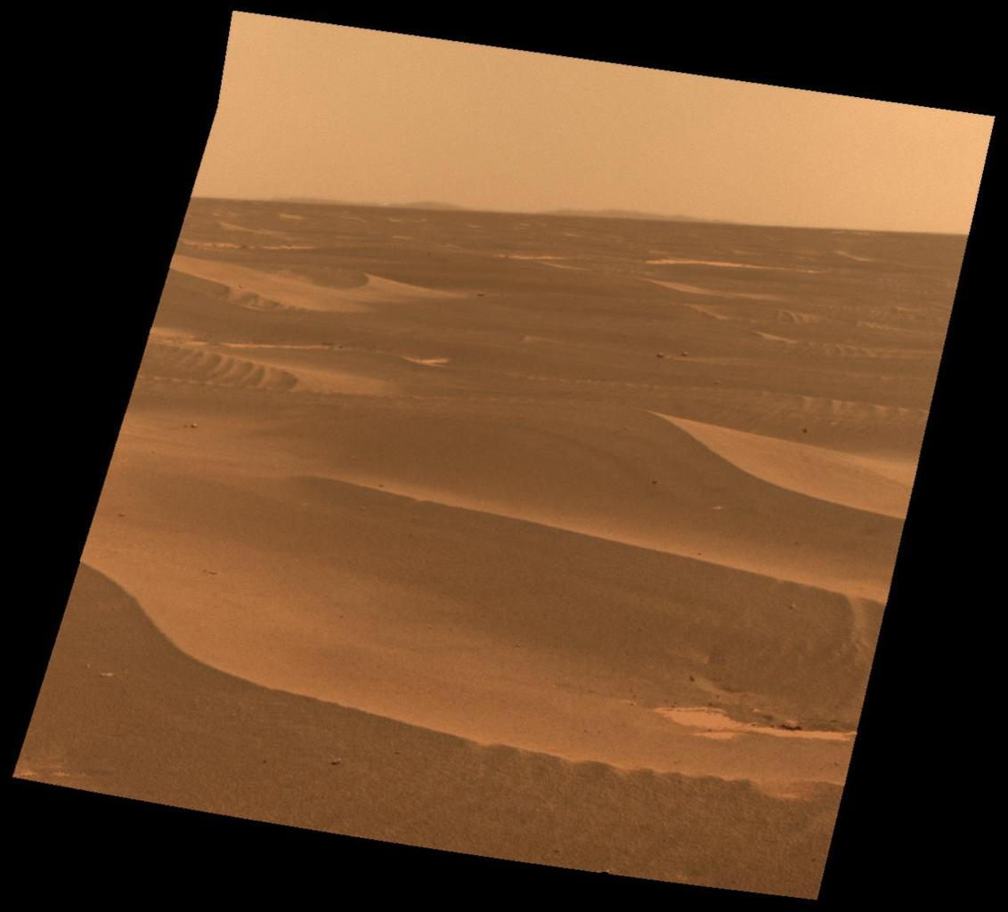 NASA's Mars Exploration Rover used its panoramic camera to record this view of the rim of a crater about 65 kilometers (40 miles) in the distance, on the southwestern horizon. This crater, Bopolu, is about 19 kilometers (12 miles) in diameter.