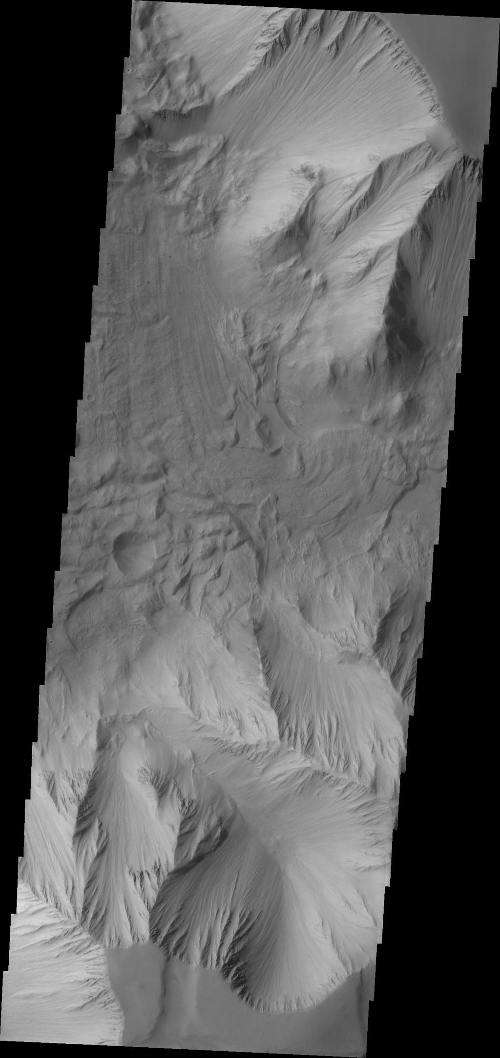 This image captured by NASA's 2001 Mars Odyssey spacecraft is part of Tithonium Chasma, part of the western side of Valles Marineris.