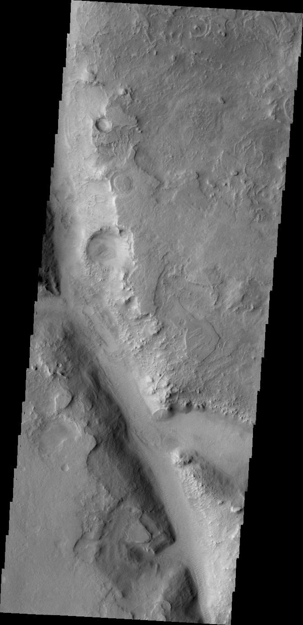 This image taken by NASA's 2001 Mars Odyssey shows just one of the many channels located in the northern part of Terra Sabaea which is heavily fractured and channeled, breaking up into a chaotic terrain as the elevation drops down to the northern plains.