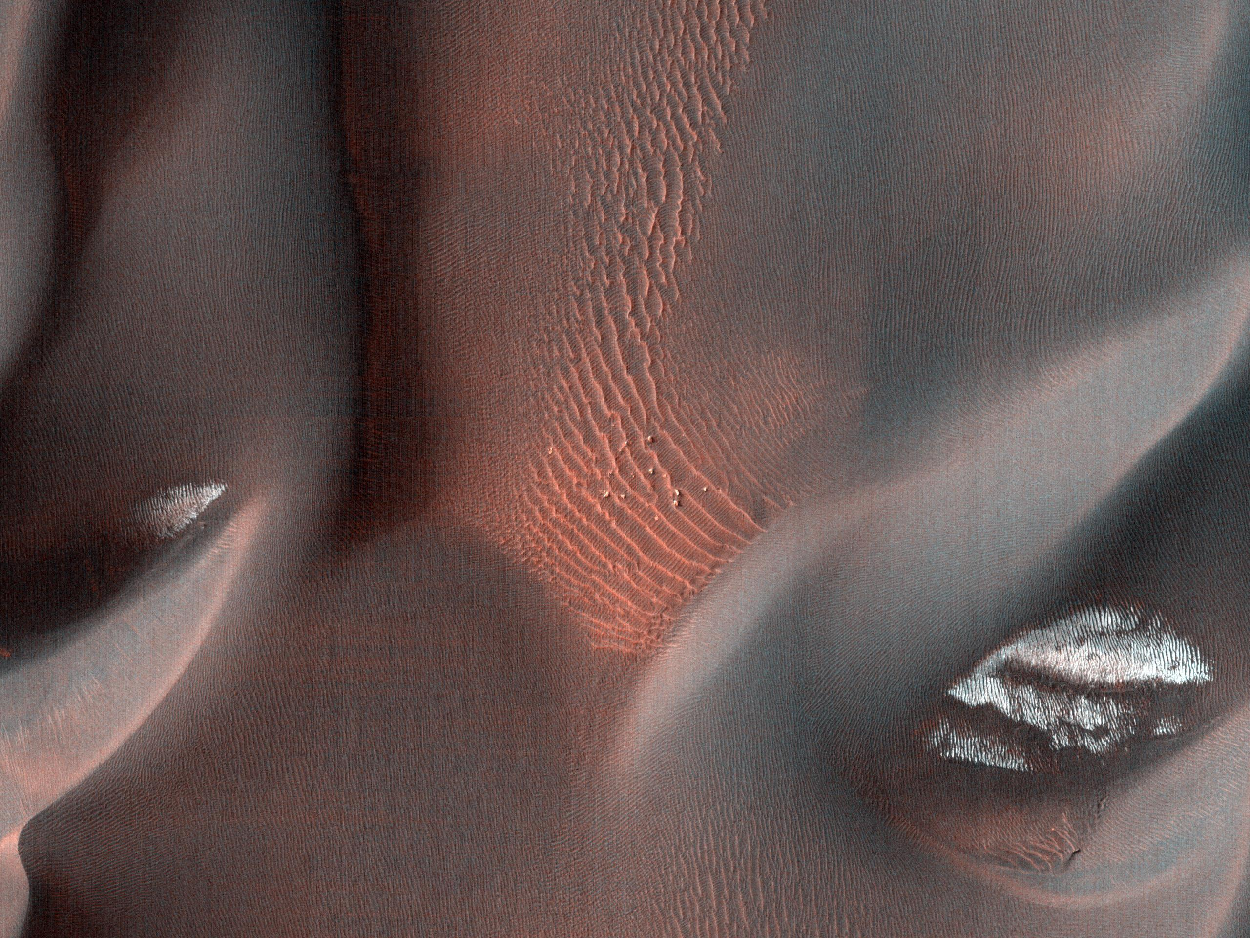 This image captured by NASA's Mars Reconnaissance Orbiter shows the edge of a dark dune field on the floor of Proctor Crater, a 150 kilometer diameter crater in the southern highlands of Mars.