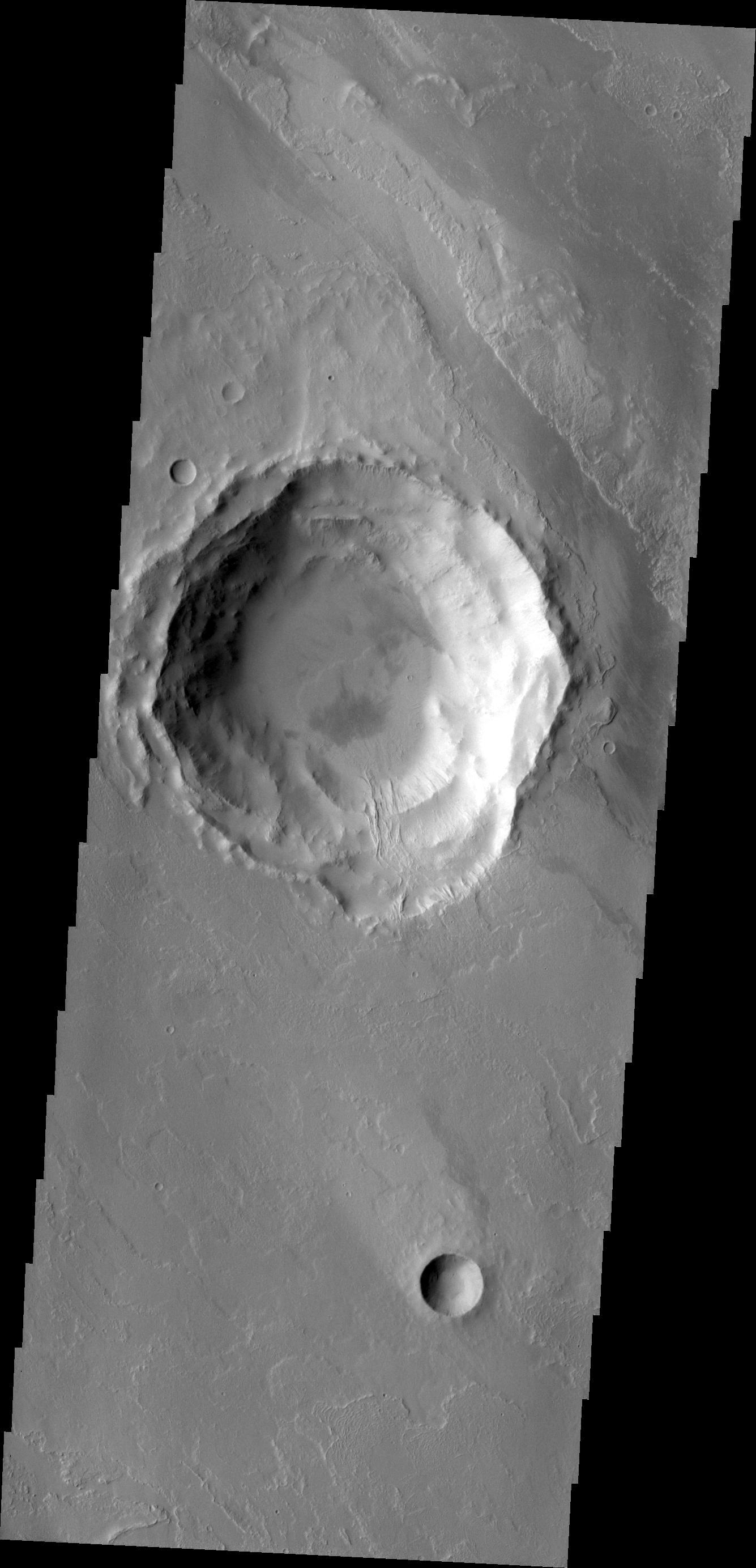 This image from NASA's 2001 Mars Odyssey shows a lava flow that topped the rim of an impact crater and flowed down to the floor of the crater.