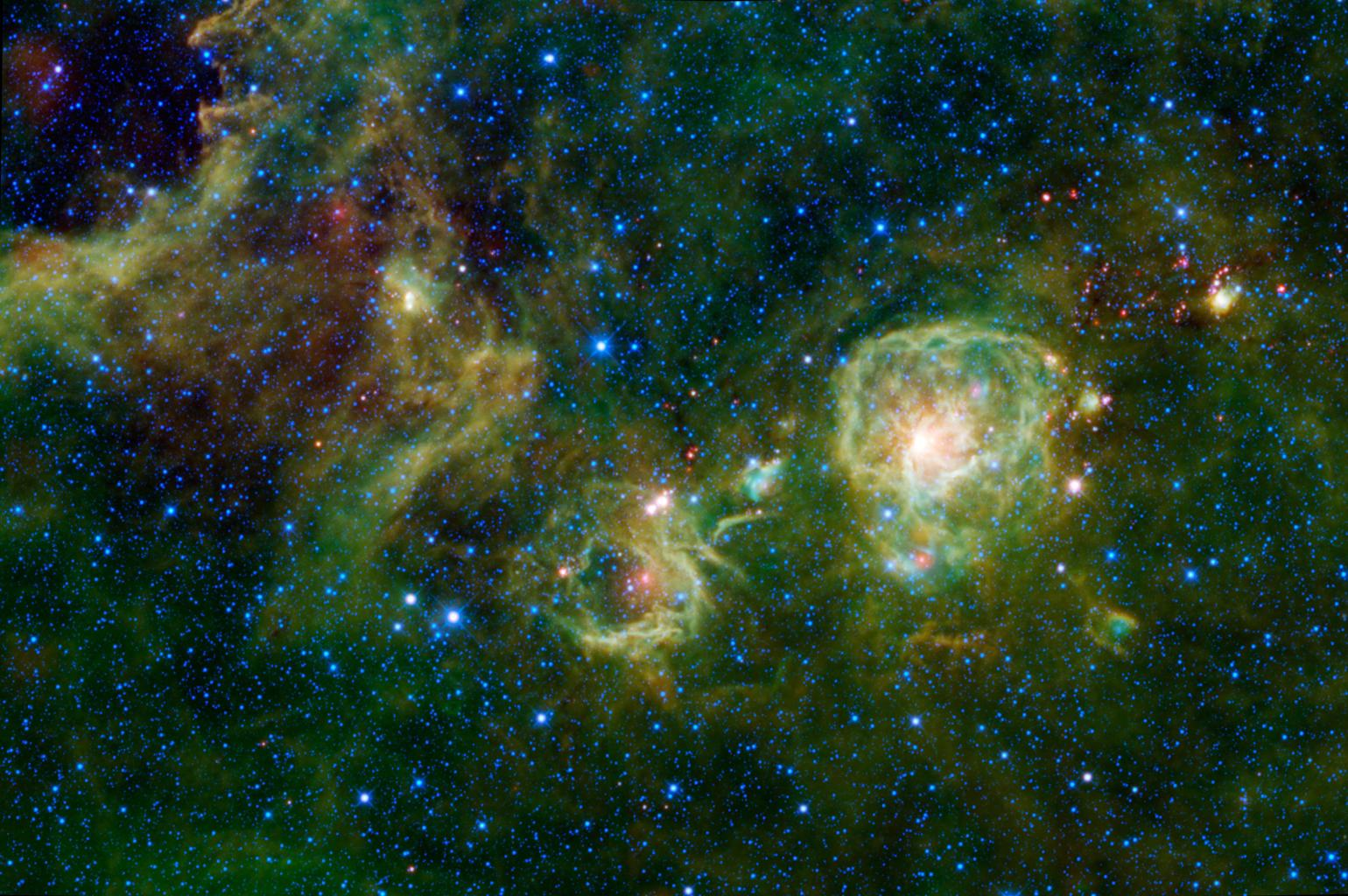 New stars are forming inside this giant cloud of dust and gas as seen in infrared light by NASA's Wide-field Infrared Survey Explorer, spanning across the constellation Vela.
