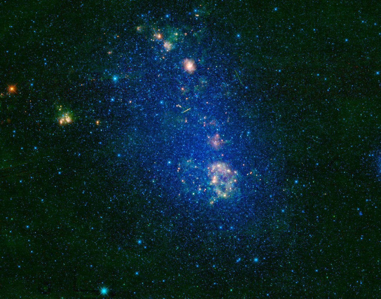 NASA's Wide-field Infrared Survey Explorer highlights the Small Magellanic Cloud, a small galaxy about 200,000 light-years away. Located in the constellation Tucana, the Small Magellanic Cloud looks like a wispy cloud encircling the south celestial pole.