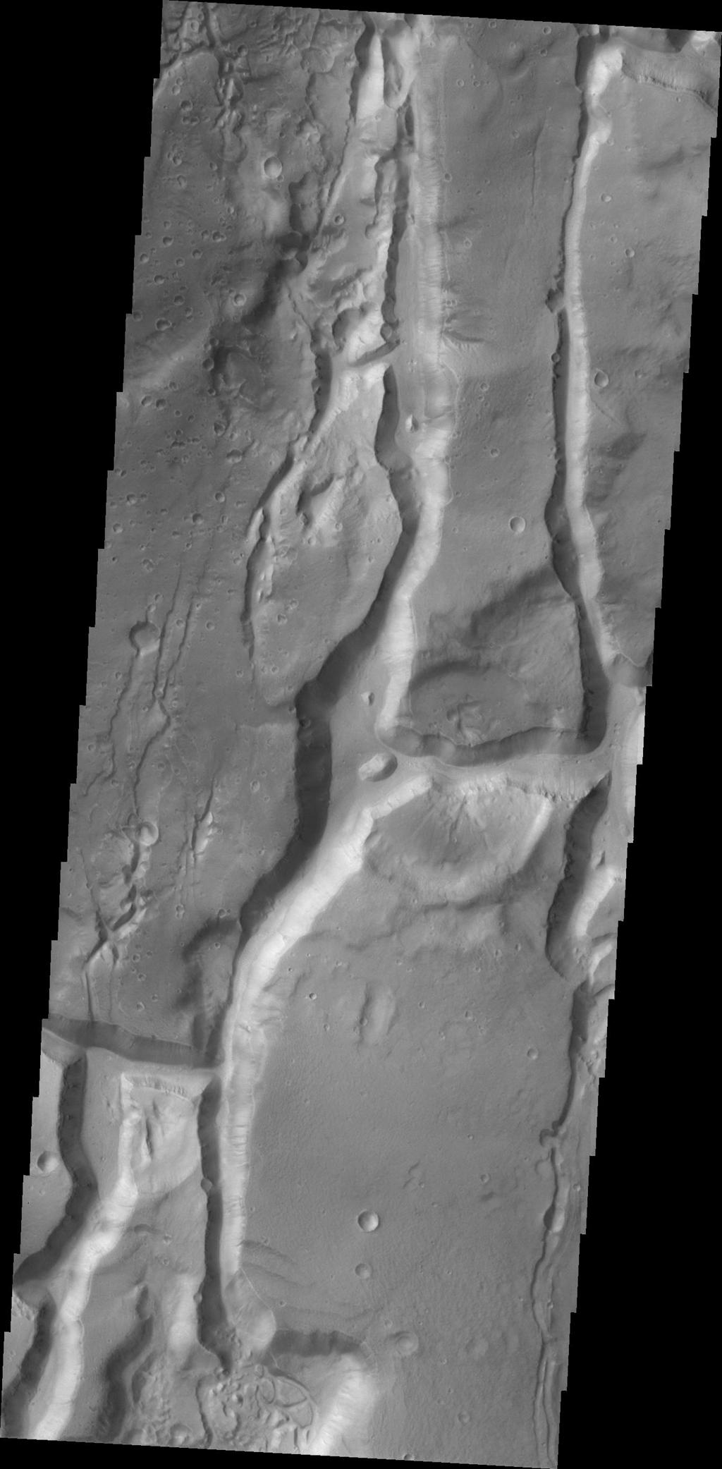 This image from NASA's 2001 Mars Odyssey highlights the fractured region of a portion of Cydonai Mensae.