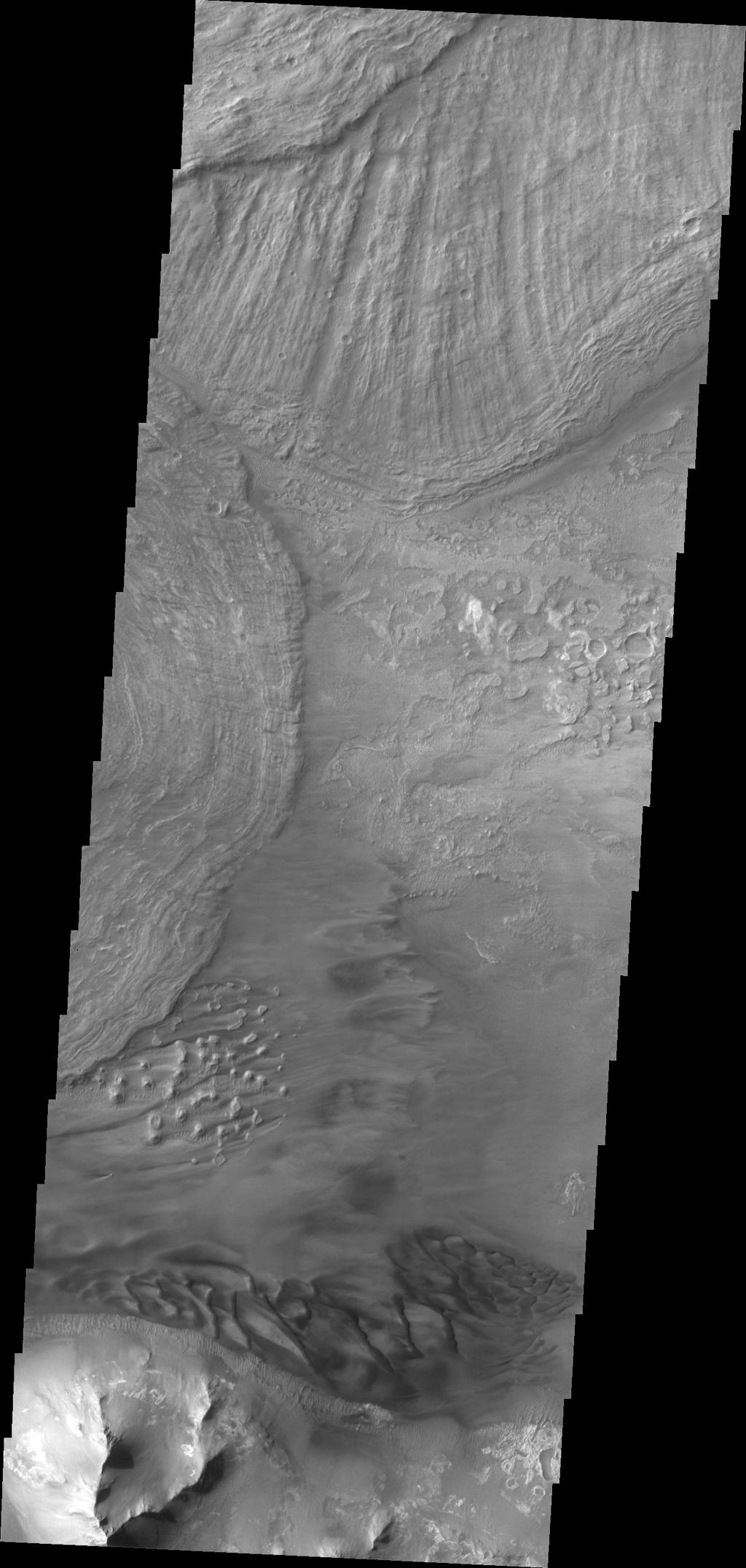 Large landslide deposits dominate this image of Ius Chasma captured by NASA's 2001 Mars Odyssey. Dunes are visible at the bottom of the frame.