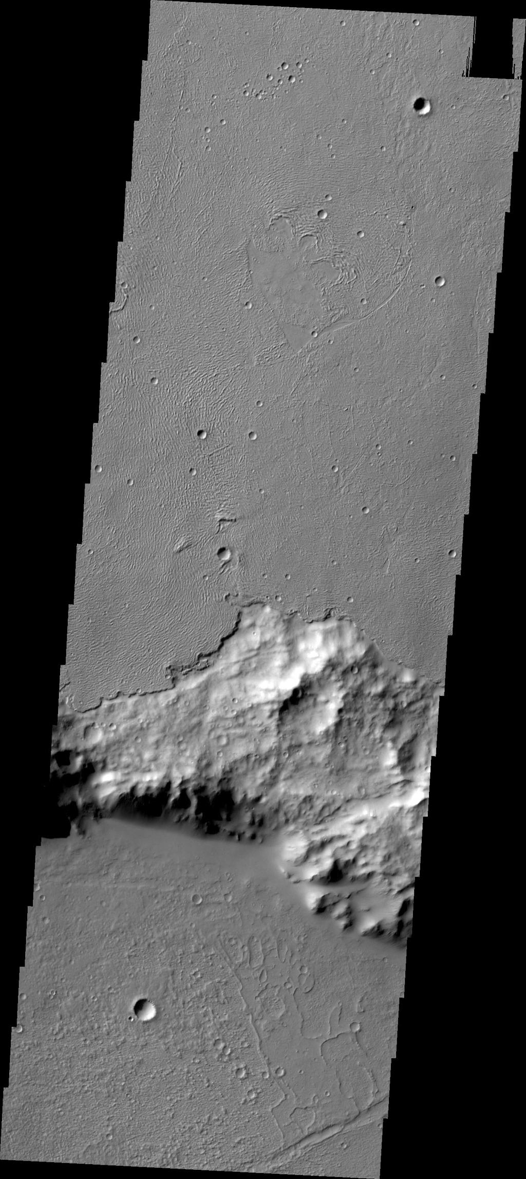 In some regions of Mars the relative ages of different materials can be determined. In this image, captured by NASA's 2001 Mars Odyssey, the younger lava flows of Daedalia Planum are on top of the older Terra Sirenum materials.
