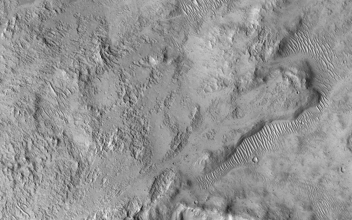 NASA's Mars Reconnaissance Orbiter spied this small 2 kilometer-wide crater when a meteoroid struck the ground just to the west and created a new, larger crater (not shown).