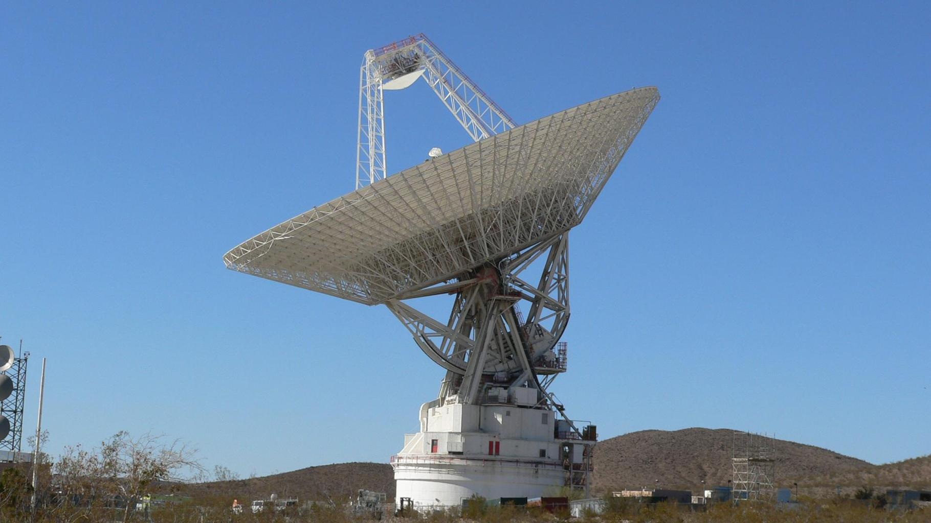The giant, 70-meter-wide antenna at NASA's Deep Space Network complex in Goldstone, Calif., tracks a spacecraft on Nov. 17, 2009. This antenna, officially known as Deep Space Station 14, is also nicknamed the 'Mars antenna.'
