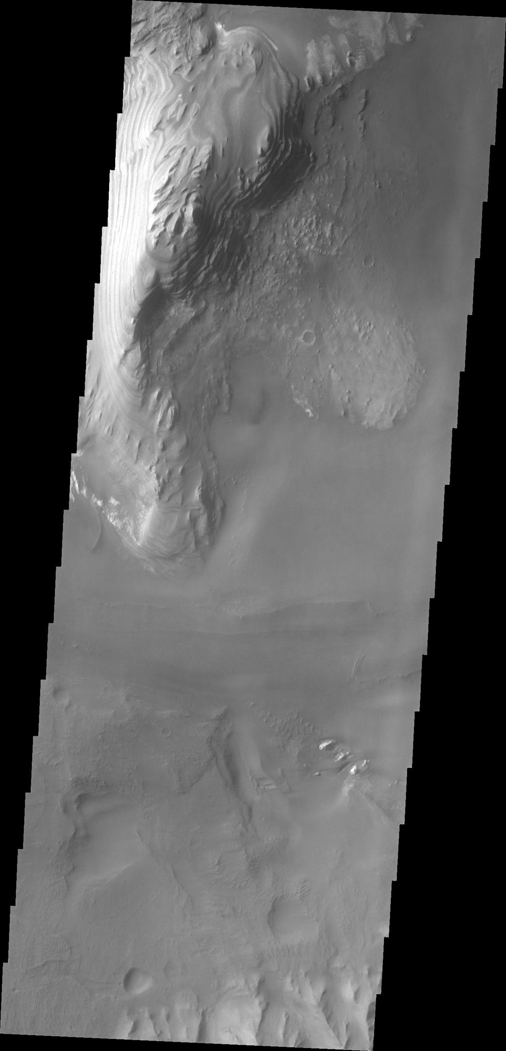 Layering is visible in these deposits on the floor of Juventae Chasma in this image captured by NASA's 2001 Mars Odyssey.