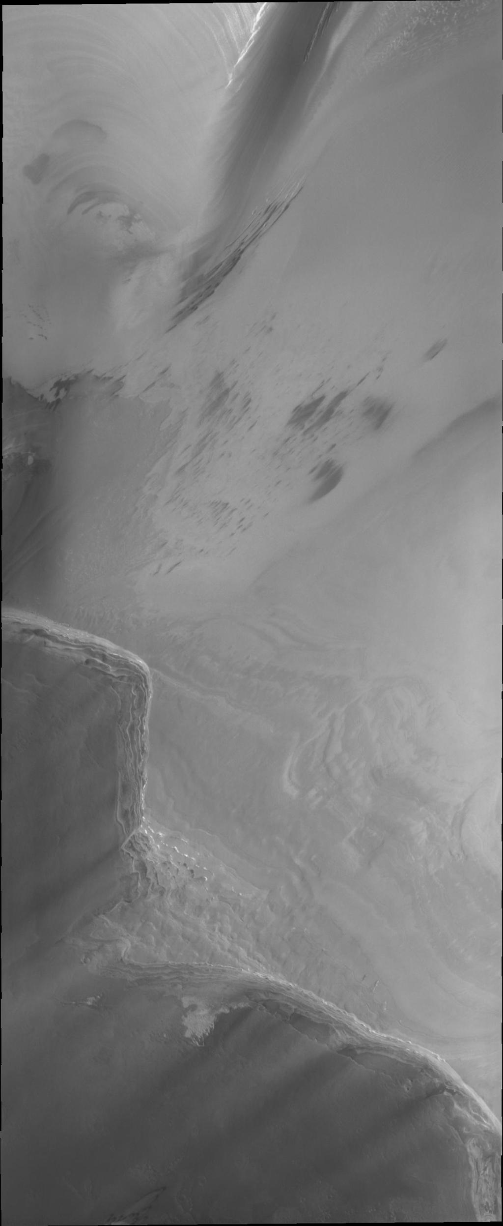 Both polar caps on Mars are composed of many layers of ice and dust. This image from NASA's Mars Odyssey clearly shows the layering of the North polar cap.