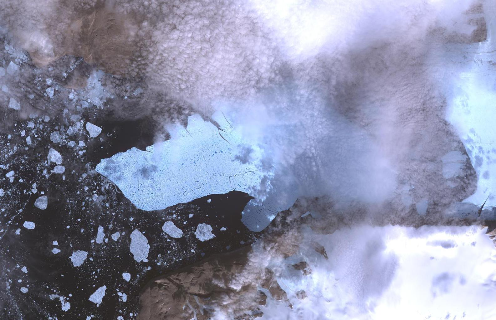 This image of Petermann Glacier and the new iceberg was acquired from NASA's Terra spacecraft on Aug. 12, 2010. On Aug. 5, 2010, an enormous chunk of ice broke off the Petermann Glacier along the northwestern coast of Greenland.