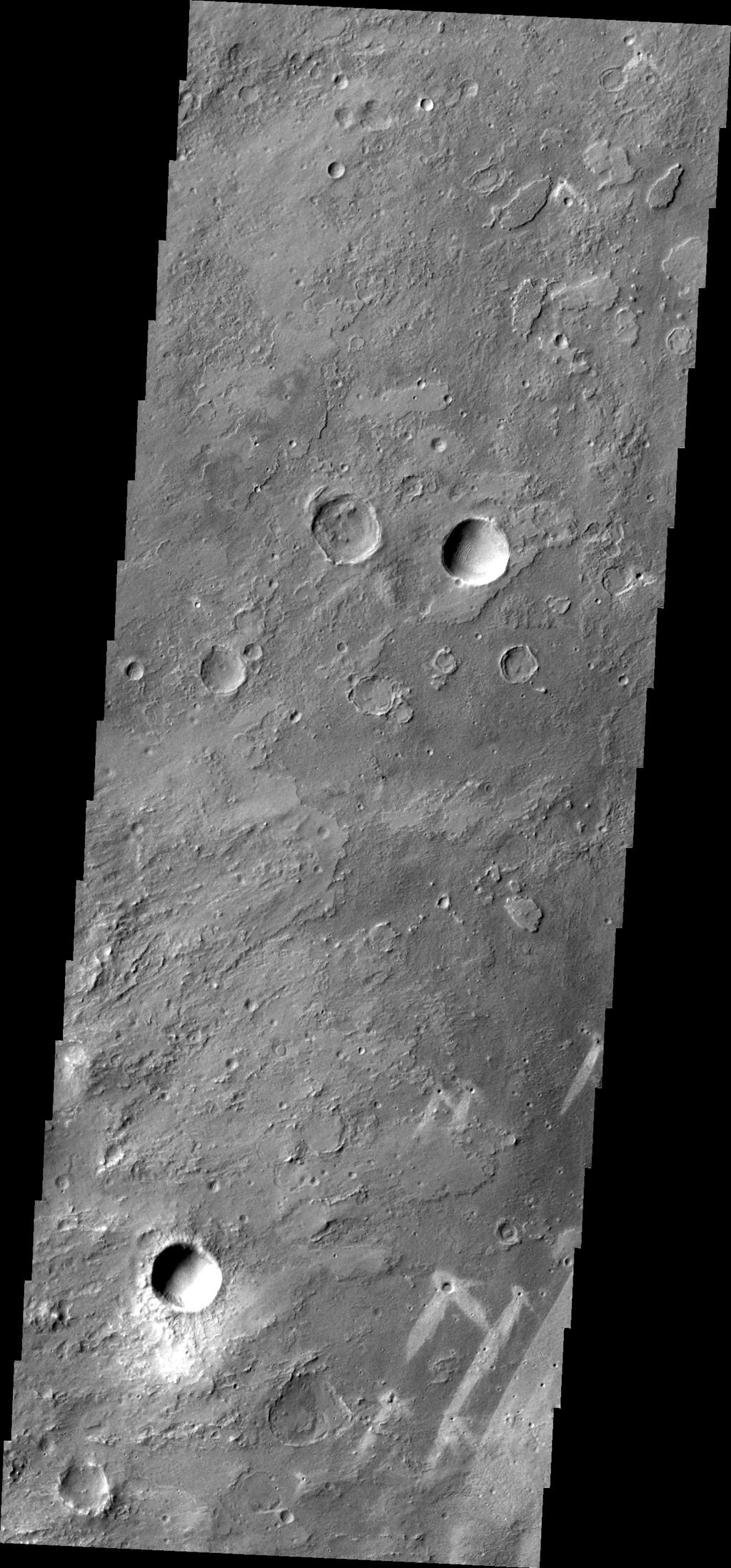 This image from NASA's Mars Odyssey of part of Meridiani Planum contains windstreaks that formed in several directions around a single crater. This indicates that wind directions changed, forming new tails for each prevailing wind direction.