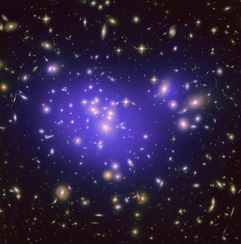 This image from NASAs Hubble Space Telescope shows the inner region of Abell 1689, an immense cluster of galaxies. Scientists say the galaxy clusters we see today have resulted from fluctuations in the density of matter in the early universe. Credit: NASA/ESA/JPL-Caltech/Yale/CNRS