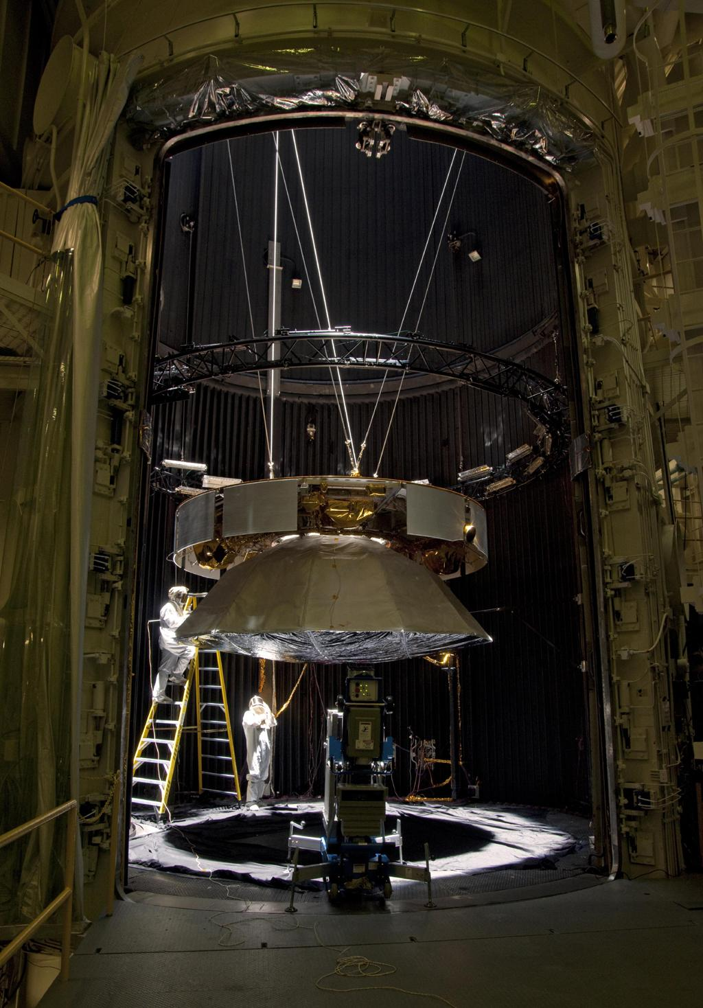 Testing of the cruise stage for NASA's Mars Science Laboratory in August 2010 included a session in a facility that simulates the environment found in interplanetary space. Spacecraft technicians at JPL prepare a space-simulation test.