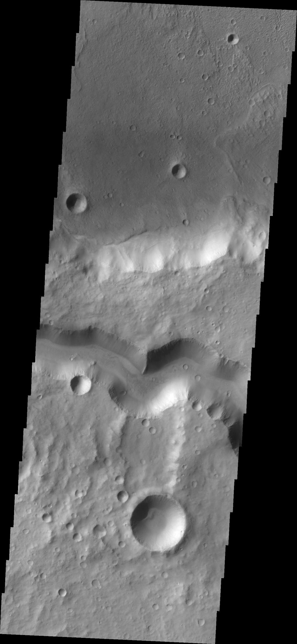 The wide channel in this image captured by NASA's Mars Odyssey is Tinto Vallis.
