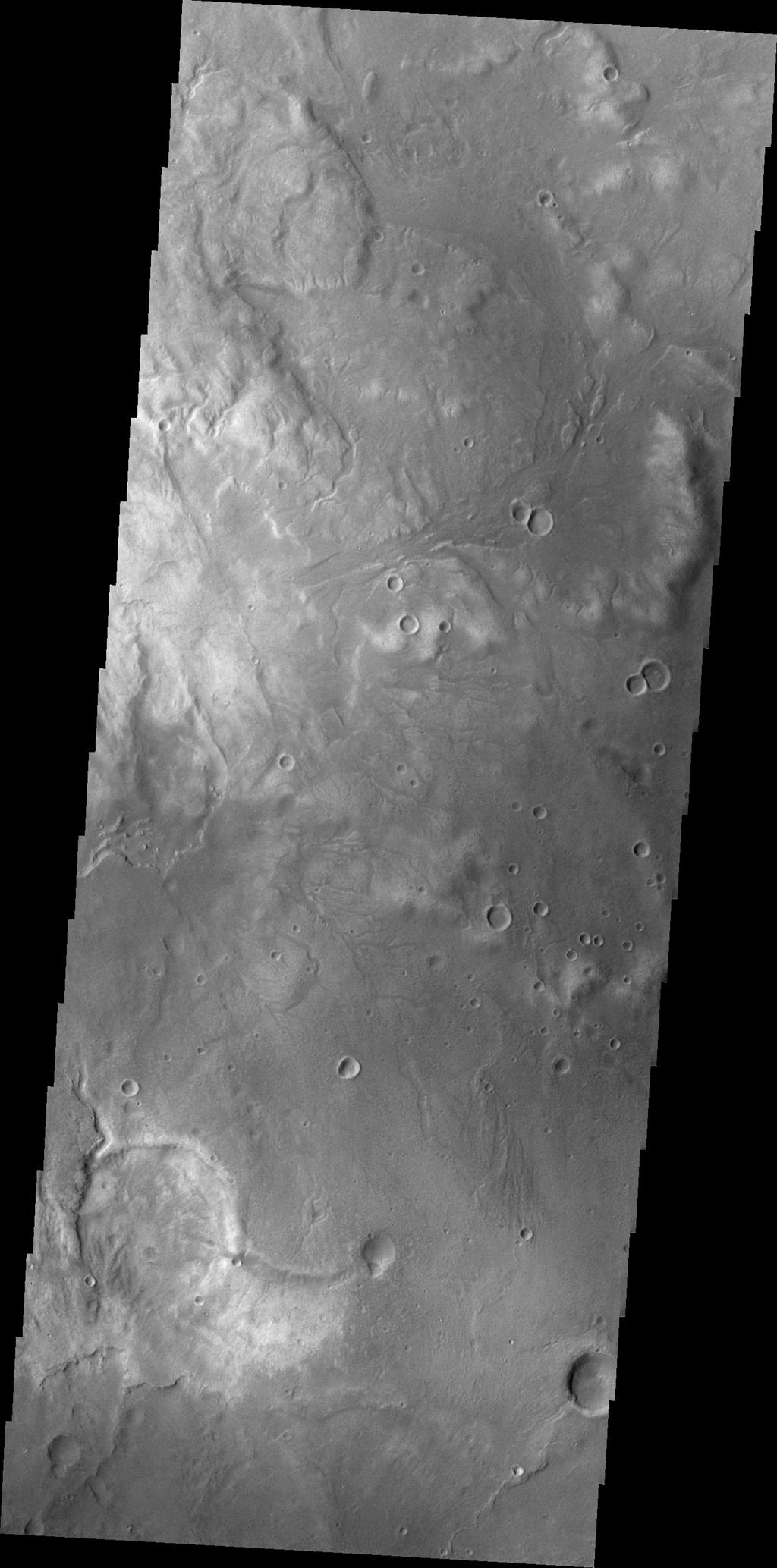 Small unnamed channels drain the surface in this region of Arabia Terra were captured by NASA's Mars Odyssey on August 3, 2010.