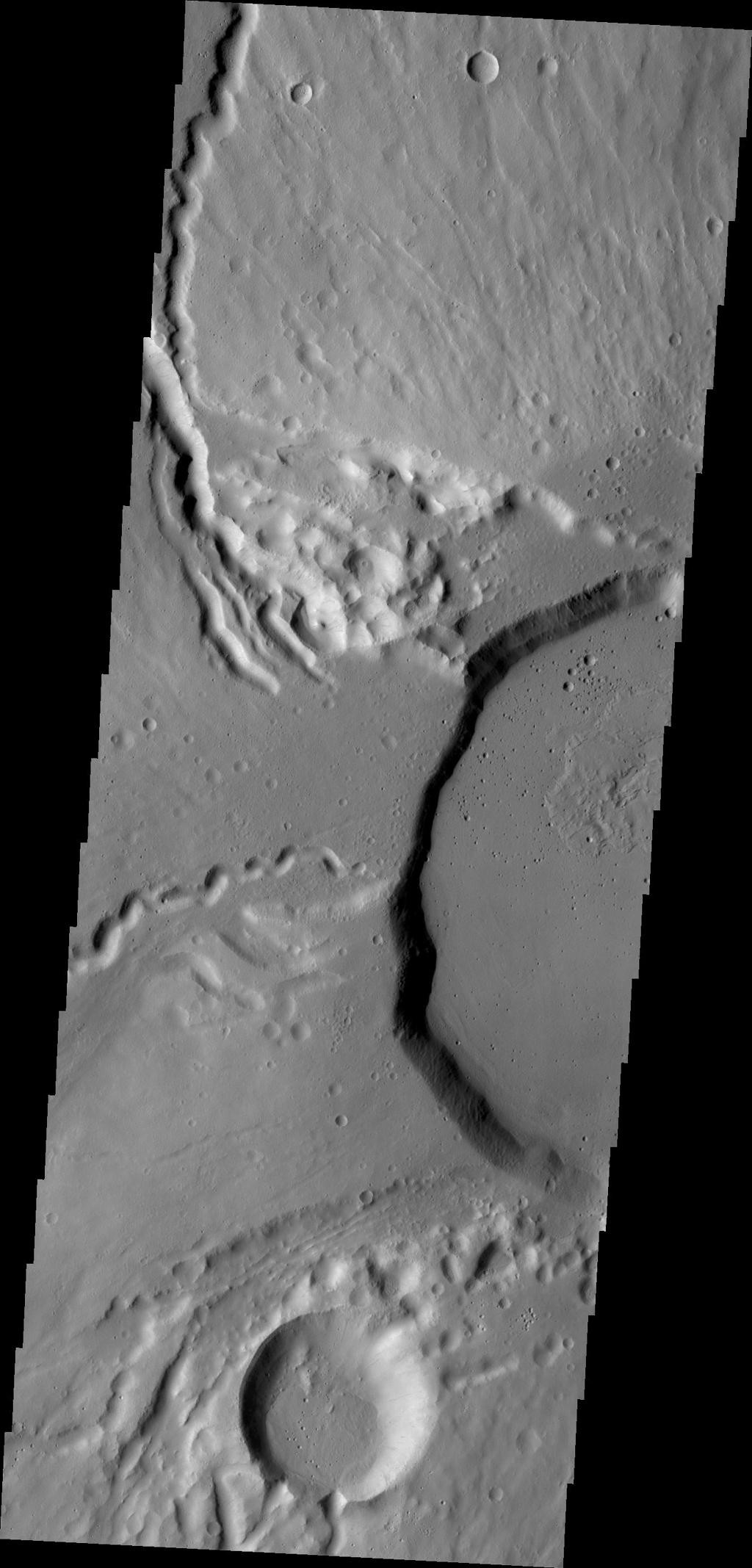 This image from NASA's Mars Odyssey shows part of the summit of Ceraunius Tholus.