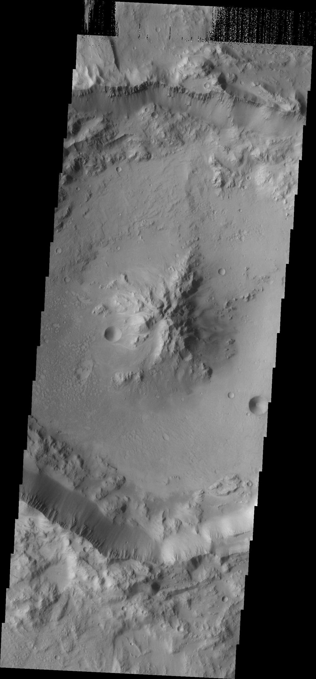 As crater size increases, craters become more complex. This moderate size crater contains a central peak, created by rebound of molten material just following the impact. This image was captured by NASA's Mars Odyssey on Sept. 8, 2010.