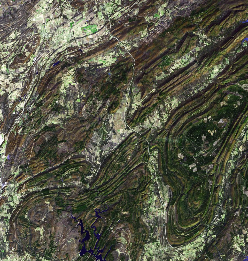 NASA's Terra spacecraft captured this image of the Ouachita Mountains in southeast Oklahoma. The Ouachitas are fold mountains, formed about 300 million years ago when the South American Plate drifted northward, colliding with the North American Plate.