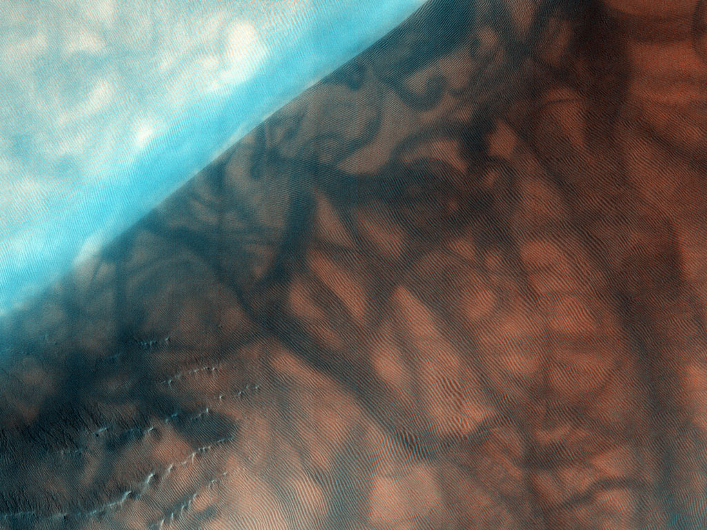 The Russell Crater dune field is covered seasonally by carbon dioxide frost; this image from NASA's Mars Reconnaissance Orbiter shows the dune field after the frost has sublimated. There are just a few patches left of the bright seasonal frost.