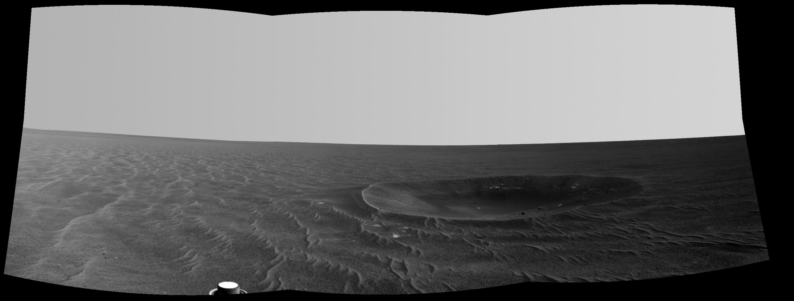 "This mosaic is a view from NASA's Mars Exploration Rover Opportunity of ""Yankee Clipper"" crater which carries the name of the command and service module of NASA's 1969 Apollo 12 mission to the moon."