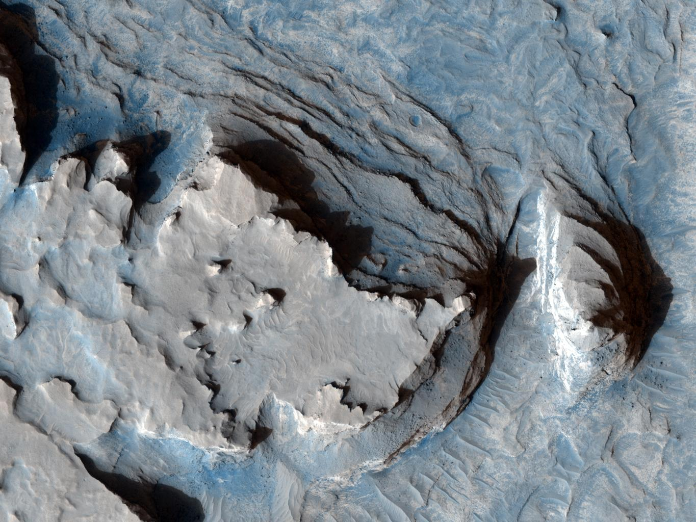 This image from NASA's Mars Reconnaissance Orbiter shows an arcuate ridge in Terra Meridiani.The ridge is most likely a former streambed, now exposed in inverted relief.