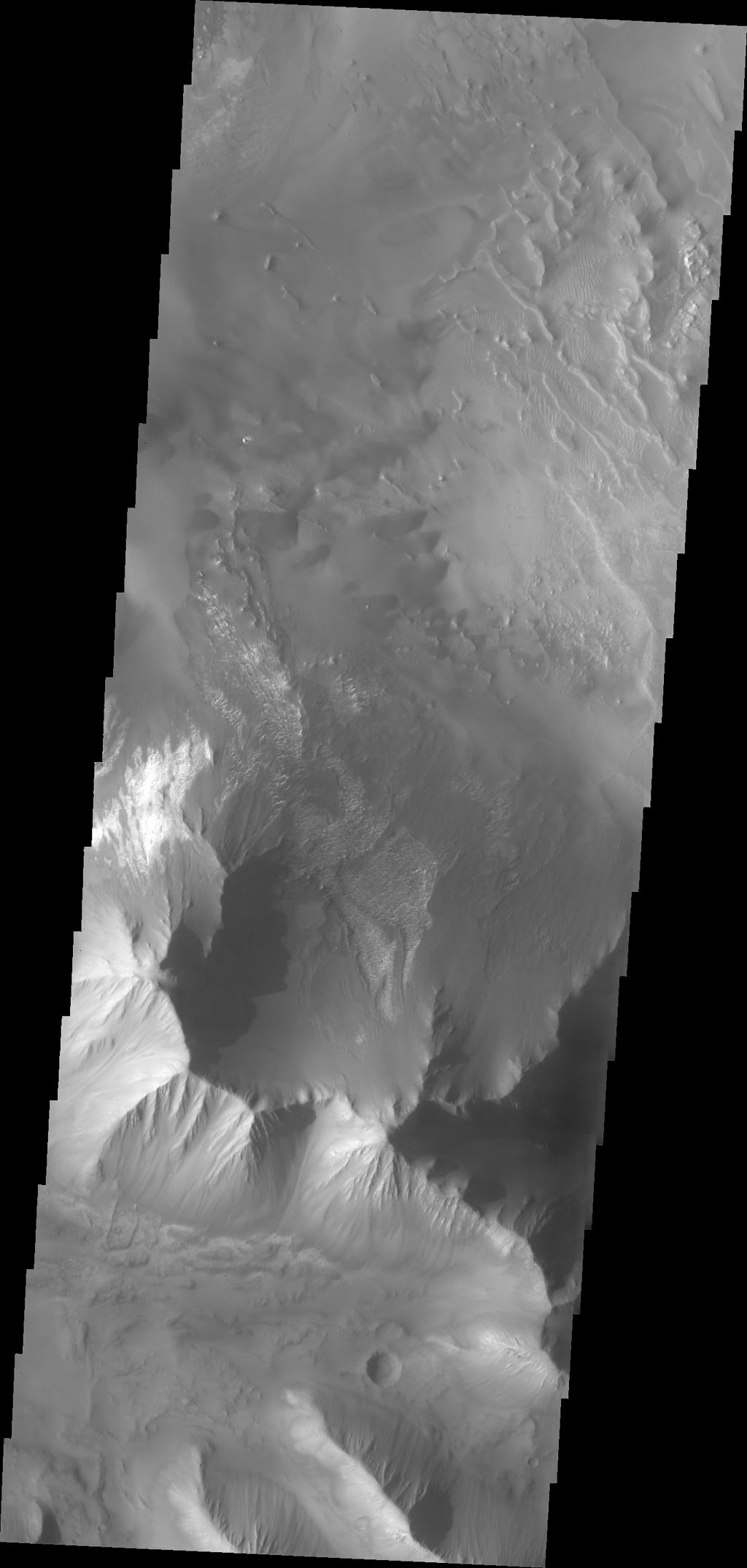 This image from NASA's Mars Odyssey shows a portion of Tithonium Chasma, part of western Valles Marineris.