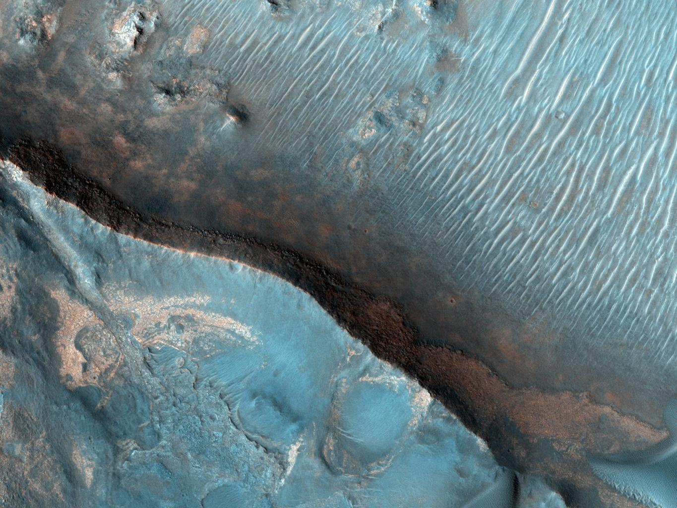 This image from NASA's Mars Reconnaissance Orbiter shows Nili Fossae region of Mars, one of the largest exposures of clay minerals, and a prime candidate landing site for Mars Science Laboratory rover, Curiosity.