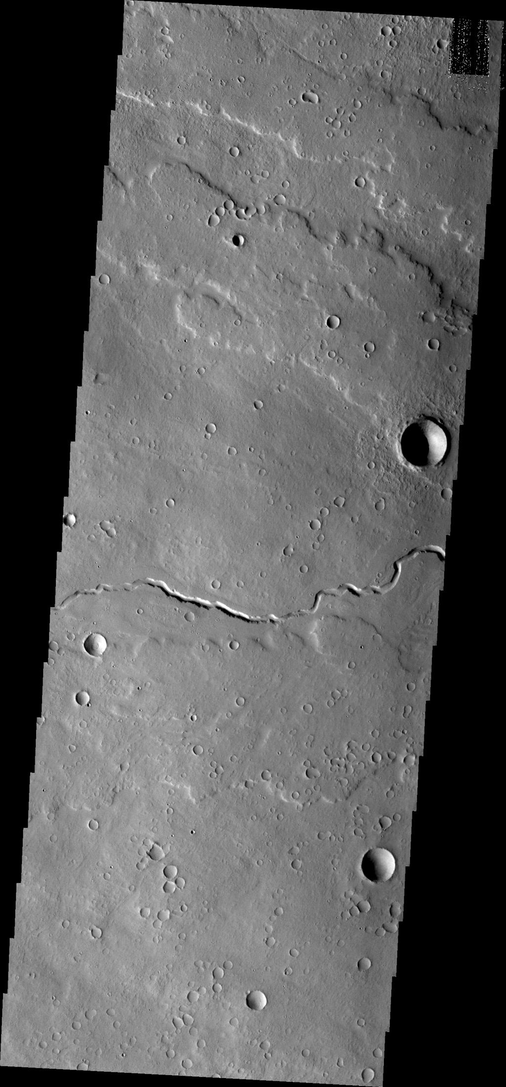 This channel is located in the volcanic flows north of Olympus Mons as seen by NASA's Mars Odyssey.