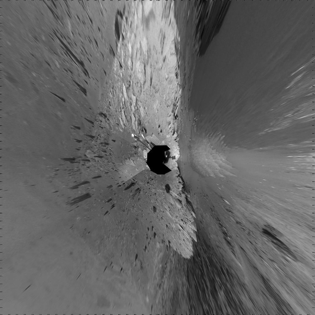 "This 360-degree mosaic of images from the navigation camera on NASA's Mars Exploration Rover Opportunity shows the view from the western rim of ""Santa Maria"" crater is presented as a vertical projection, with north at the top."