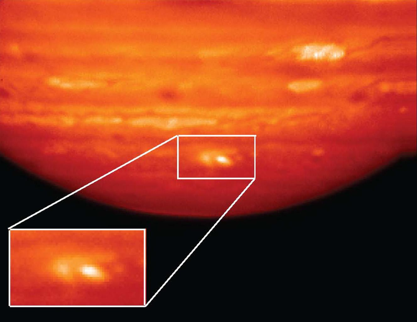 This infrared image, showing thermal radiation at a wavelength of 9.7 microns, was obtained by the Gemini North Telescope in Hawaii. The bright white and yellow features at bottom are the aftermath of an impactor hitting Jupiter on July 19, 2009.