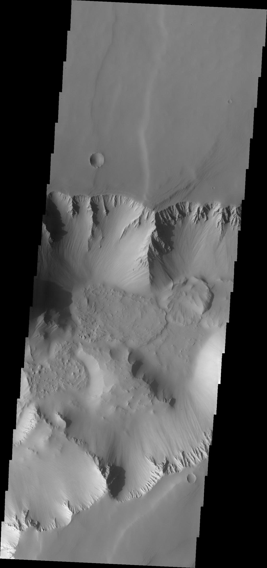 NASA's Mars Odyssey shows the location of the complexly fractured region called Noctis Labyrinthus at the westernmost end of Valles Marineris. The canyon systems in Noctis Labyrinthus do not reach the depths of the chasma of Valles Marineris.