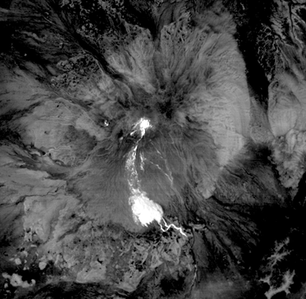 This nighttime thermal infrared image from NASA's Terra spacecraft shows Shiveluch volcano, one of the largest and most active volcanoes in Russia's Kamchatka Peninsula; the bright, hot summit lava dome is evident in the center of the image.