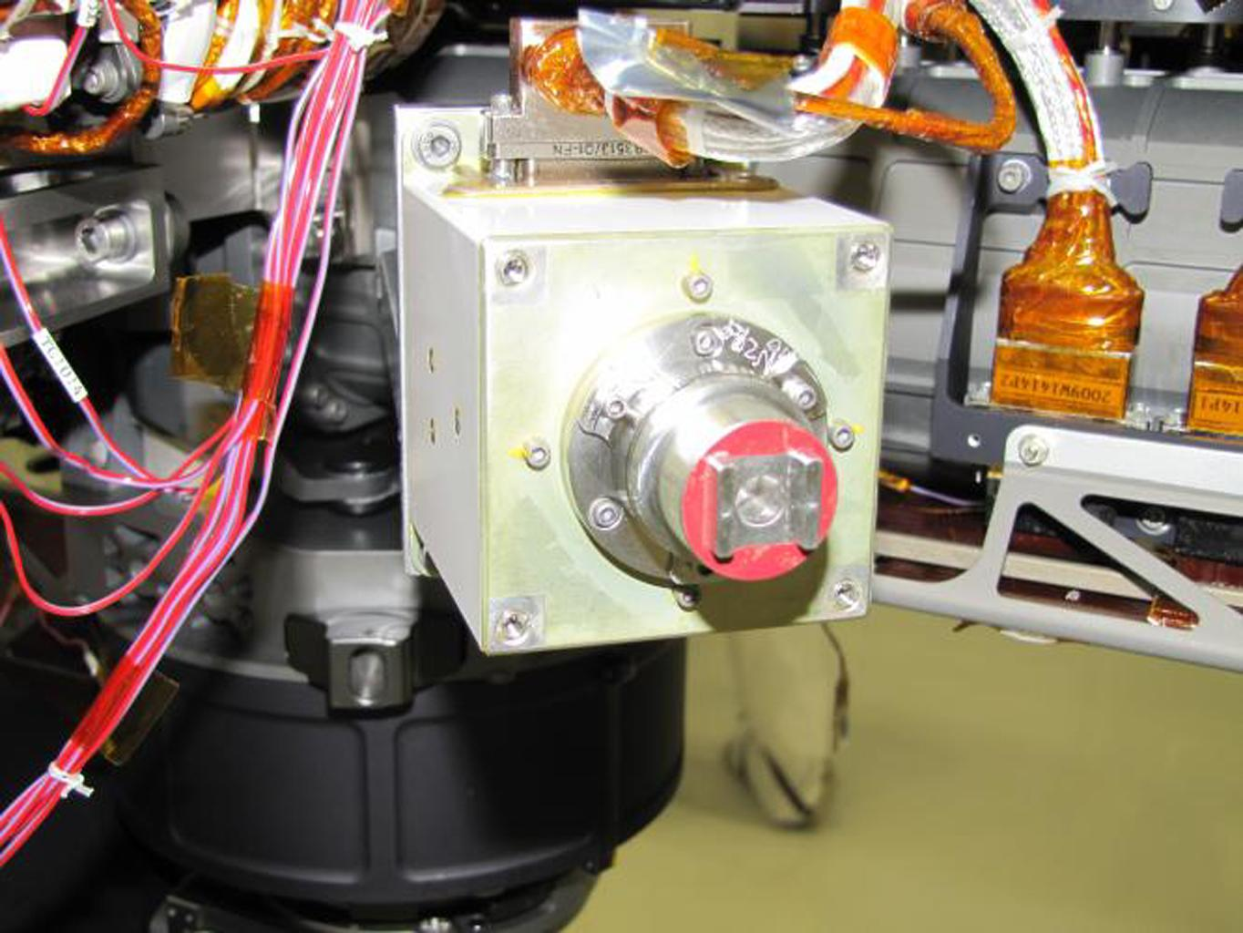 The sensor head on the Alpha Particle X-ray Spectrometer instrument was installed during testing at NASA's Jet Propulsion Laboratory. The instrument is part of NASA's Curiosity rover.