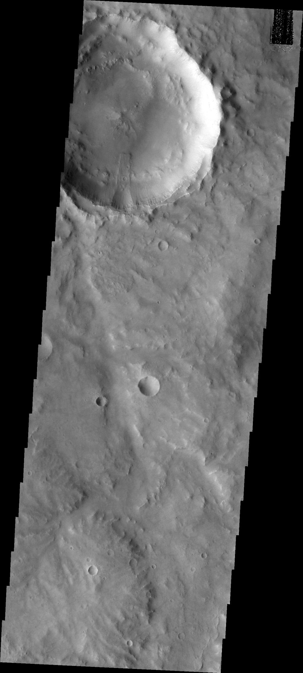 A landslide occurred from the rim of this unnamed crater in Margaritifer Terra as seen by NASA's Mars Odyssey.