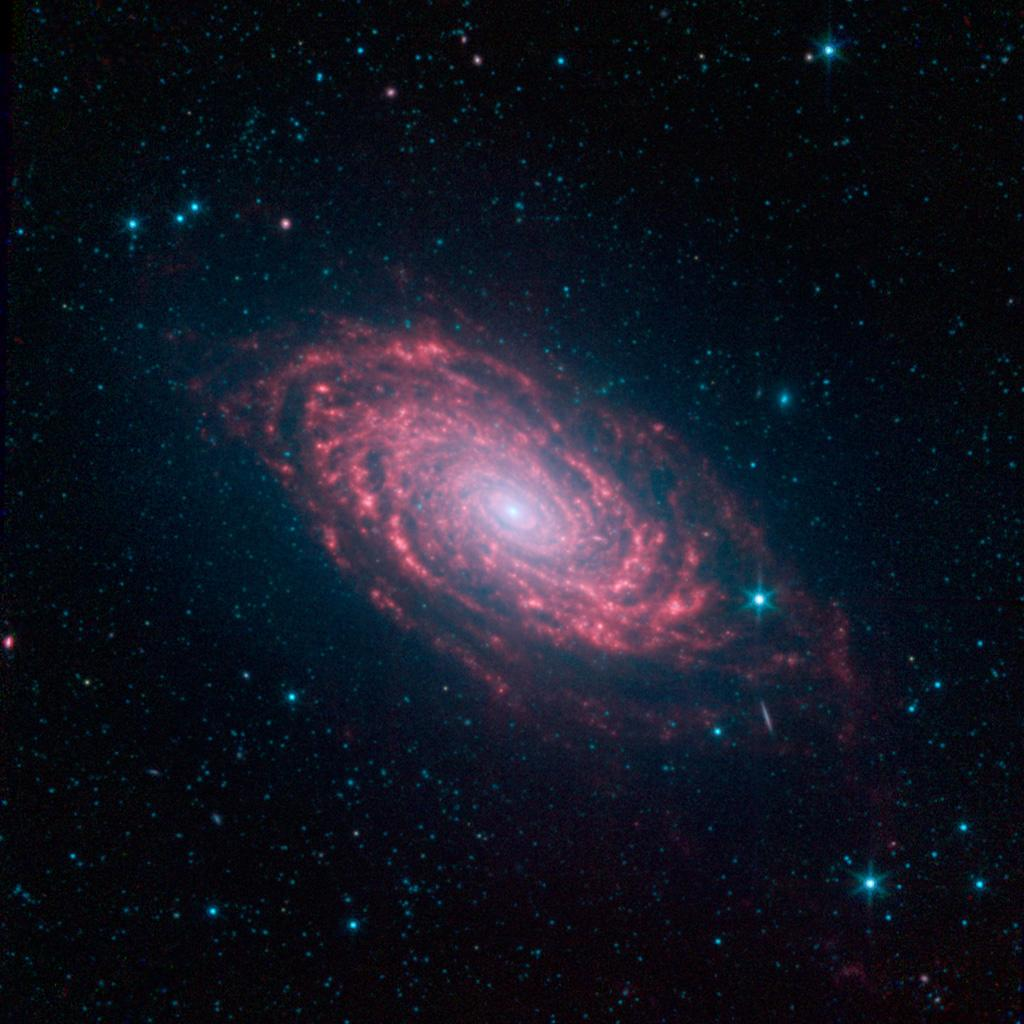 This view of the Sunflower galaxy highlights a variety of infrared wavelengths captured by NASA's Spitzer Space Telescope.