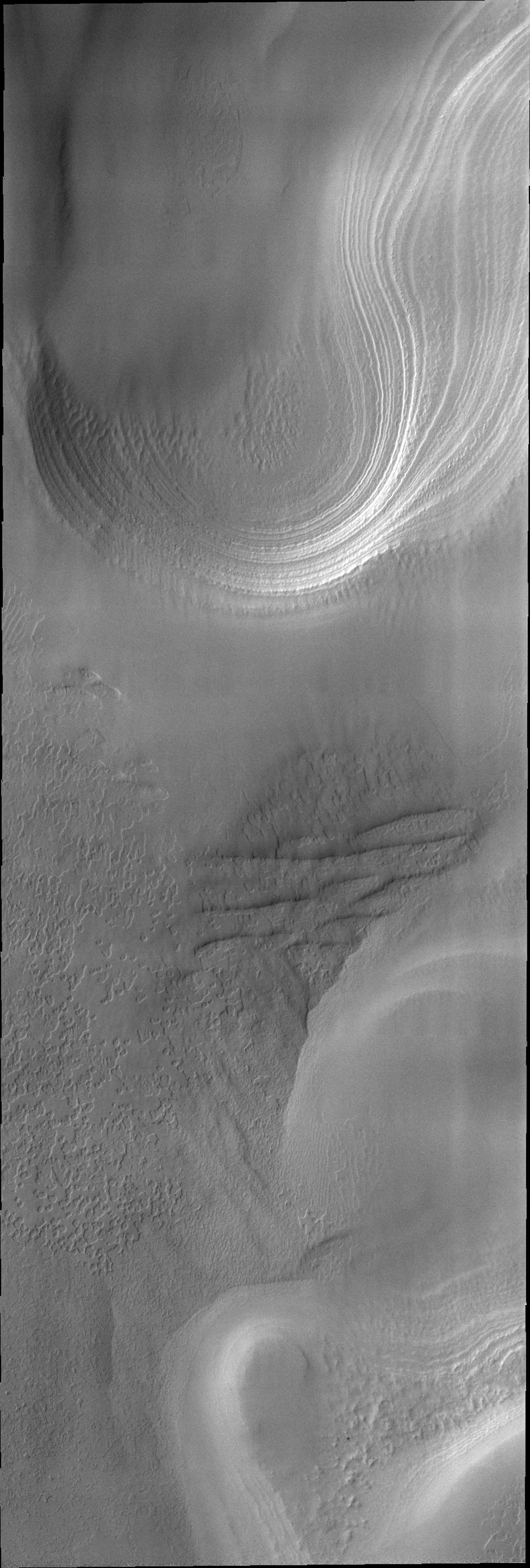 This image captured by NASA's Mars Odyssey shows layering in the south polar cap.