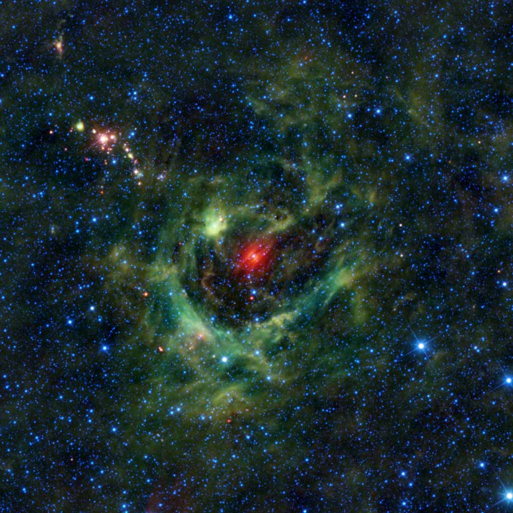 Today's image from NASA's Wide-field Infrared Survey Explorer, or WISE, features a region of star birth wrapped in a blanket of dust, colored green in this infrared view.